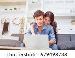 couple watching notebook in...   Shutterstock . vector #679498738