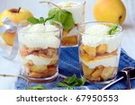 dessert apples and whipped cream in a glass beaker - stock photo