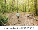 boy walking through forest....   Shutterstock . vector #679509910
