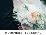 wedding bouquet in the hands of ... | Shutterstock . vector #679520440