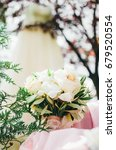 wedding bouquet among greens on ... | Shutterstock . vector #679520554