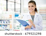 smiling asian female pharmacist ... | Shutterstock . vector #679521298