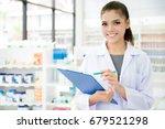 smiling asian female pharmacist ... | Shutterstock . vector #679521298
