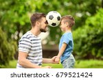 dad and son with soccer ball in ...   Shutterstock . vector #679521424