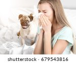 Stock photo young ill woman with tissue and pet on background concept of allergies to dogs 679543816