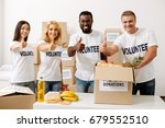 Small photo of Enthusiastic charity team happy working together
