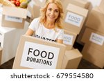Small photo of Altruistic energetic woman excited working for people