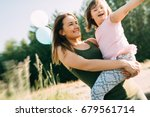 picture of mother and child... | Shutterstock . vector #679561714