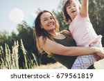 picture of mother and child... | Shutterstock . vector #679561819