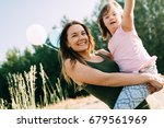 picture of mother and child... | Shutterstock . vector #679561969