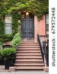 ivy covered door and front...   Shutterstock . vector #679572448