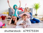 tired parents and romping kids   Shutterstock . vector #679575334