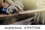 Carpenter using circular saw...