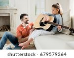 happy father looking at cute... | Shutterstock . vector #679579264