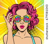 Stock vector wow pop art face sexy surprised woman with pink curly hair and open mouth holding sunglasses in 679581043