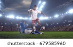 soccer player makes a dramatic... | Shutterstock . vector #679585960