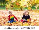kids play in autumn park....   Shutterstock . vector #679587178