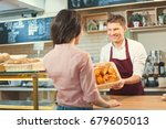 smiling people in bakery | Shutterstock . vector #679605013