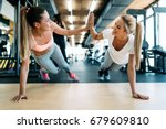 two attractive fitness girls... | Shutterstock . vector #679609810