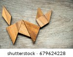 tangram puzzle in cat shape on... | Shutterstock . vector #679624228