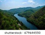 river behind dam | Shutterstock . vector #679644550