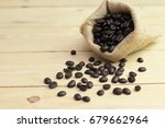 coffee bean in sack on vintage... | Shutterstock . vector #679662964