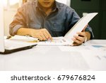Small photo of Young students sit down to research and write down statistical information to gather results summarize the book to graduate report over blurred library. select focus and Film Tone with Light fair