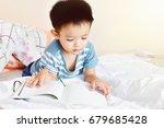 little boy child reading a book ... | Shutterstock . vector #679685428