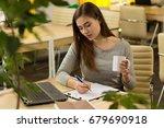 beautiful young woman making...   Shutterstock . vector #679690918