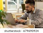 young bearded businessman...   Shutterstock . vector #679690924