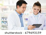 asian pharmacist team looking... | Shutterstock . vector #679693159