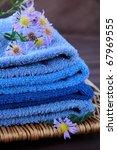 blue purple towel with flower   Shutterstock . vector #67969555