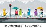 schoolboy wears a raincoat and... | Shutterstock .eps vector #679698643