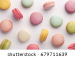 Small photo of Macarons pattern on white background. Colorful french desserts. Top view