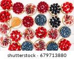 fruit and berry tarts dessert... | Shutterstock . vector #679713880