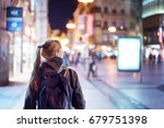 back view of girl walking on... | Shutterstock . vector #679751398