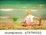 baby girl playing in the sand... | Shutterstock . vector #679790533