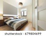 modern bedroom in beige... | Shutterstock . vector #679804699
