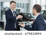 young male car dealer smiling... | Shutterstock . vector #679810894