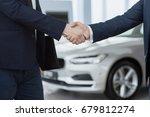 cropped close up of car dealer... | Shutterstock . vector #679812274