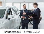 professional car dealer showing ...   Shutterstock . vector #679812610