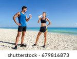 runners. young couple drinking... | Shutterstock . vector #679816873