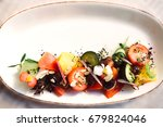healthy salad with tomatoes ... | Shutterstock . vector #679824046