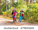 kids playing in autumn park.... | Shutterstock . vector #679833604