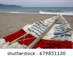 old fishing boat on empty beach | Shutterstock . vector #679851130