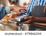 closeup of a customer using her ...   Shutterstock . vector #679866244