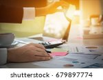 young business man hand holding ... | Shutterstock . vector #679897774