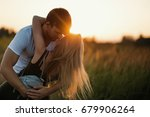 romantic couple at sunset. two... | Shutterstock . vector #679906264