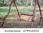 a wooden swing in the park. eco ... | Shutterstock . vector #679916953