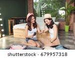 friendship. travel. two asian... | Shutterstock . vector #679957318